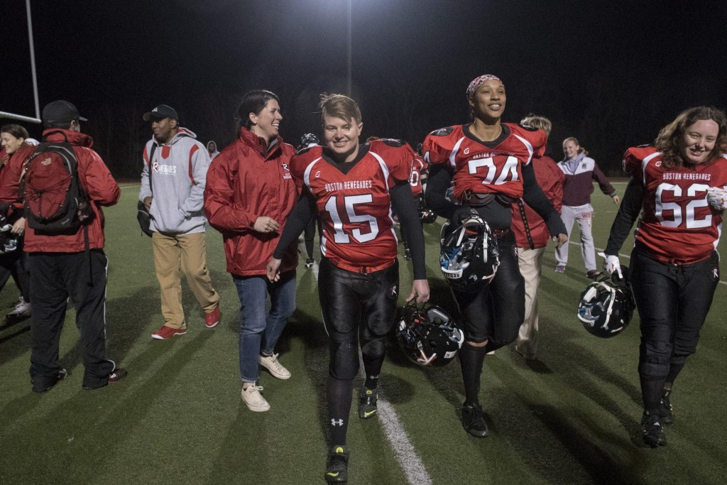 From left: Boston Renegades chief marketing officer Erin Baumgartner of Somerville, players, Kathryn Tylander of Somerville, Torrance Brown of Dedham and Michelle Vachon-Breden of Rochester, NH walk of the field after their team's 57-0 victory over the Central Maryland Seahawks at Dilboy Stadium, April 18, 2015. The Renegades were formerly the Militia owned by Ernie Boch Jr. who announced the discontinuation of the team on January 5 due to the lack of local competition. Many of the players had played with the team for years refused to go a season without playing football and worked to buy the team and enter the 2015 season as the Renegades. (Wicked Local Staff Photo/ Sam Goresh)
