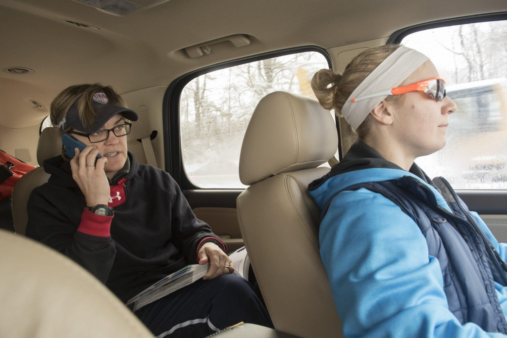 Jennifer Dulski (right) drives while Molly Goodwin (left) talks on the phone to vendors to make sure that the team's helmets will arrive in time for their scrimmage against women's football teams in the Independent Women's Football League, Pittsburgh Passion, Washington Prodigy, and Philadelphia Firebirds in Philadelphia, March 21, 2015. (Wicked Local Staff Photo/ Sam Goresh)