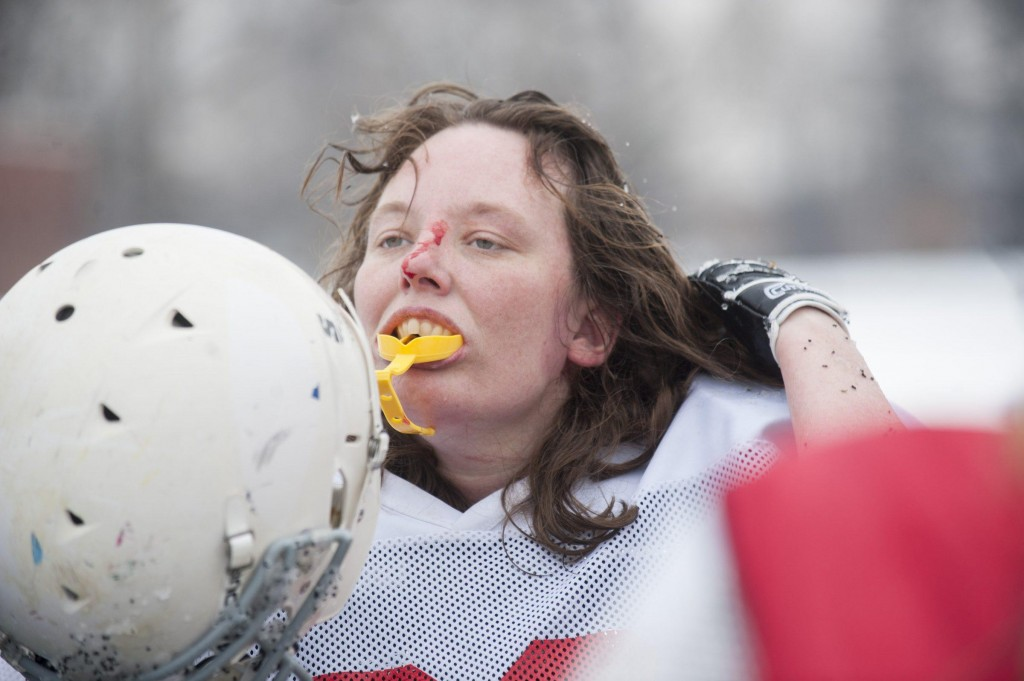Renegades defensive tackle Michelle Breden adjusts her helmet between plays in their scrimmage against the Independent Women's Football League's Washington Prodigy in Philadelphia, March 21, 2015. The team drove to Philadelphia to give a newer players a chance to play against other teams, but also to play against teams that no longer wanted to play with the Militia. (Wicked Local Staff Photo/ Sam Goresh)