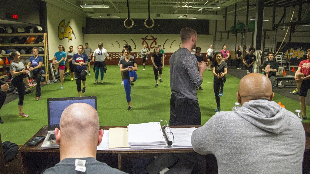 Trainer Jeremy Rubera leads the team through conditioning at CrossFit ARES in Wilmington in February. —Guru Amar Khalsa/Boston.com